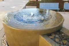 Bomanite integrally colored concrete was installed here with a smooth trowel finish to create a decorative concrete fountain at Clovis Community Medical Center and the longevity and durability of this product will ensure this feature piece can serve as a long-term reminder that every moment matters.