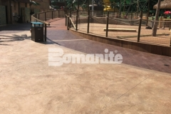 Featured here is Bomanite Bomacron Regular Slate imprinted concrete that was chosen for this space to create a durable decking surface and add texture and dimension to the hardscape.