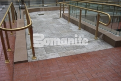 Bomanite Bomacron Medium Ashlar Slate stamped concrete was installed here to create a pedestrian bridge and wheelchair access ramps and this durable and decorative design feature adds picture-perfect form and function to this outdoor space.
