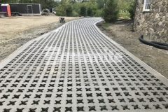 This Bomanite Grasscrete pervious concrete driveway was the perfect product to create a surface that will maintain strong structural integrity, while also mitigating drainage issues on the site.