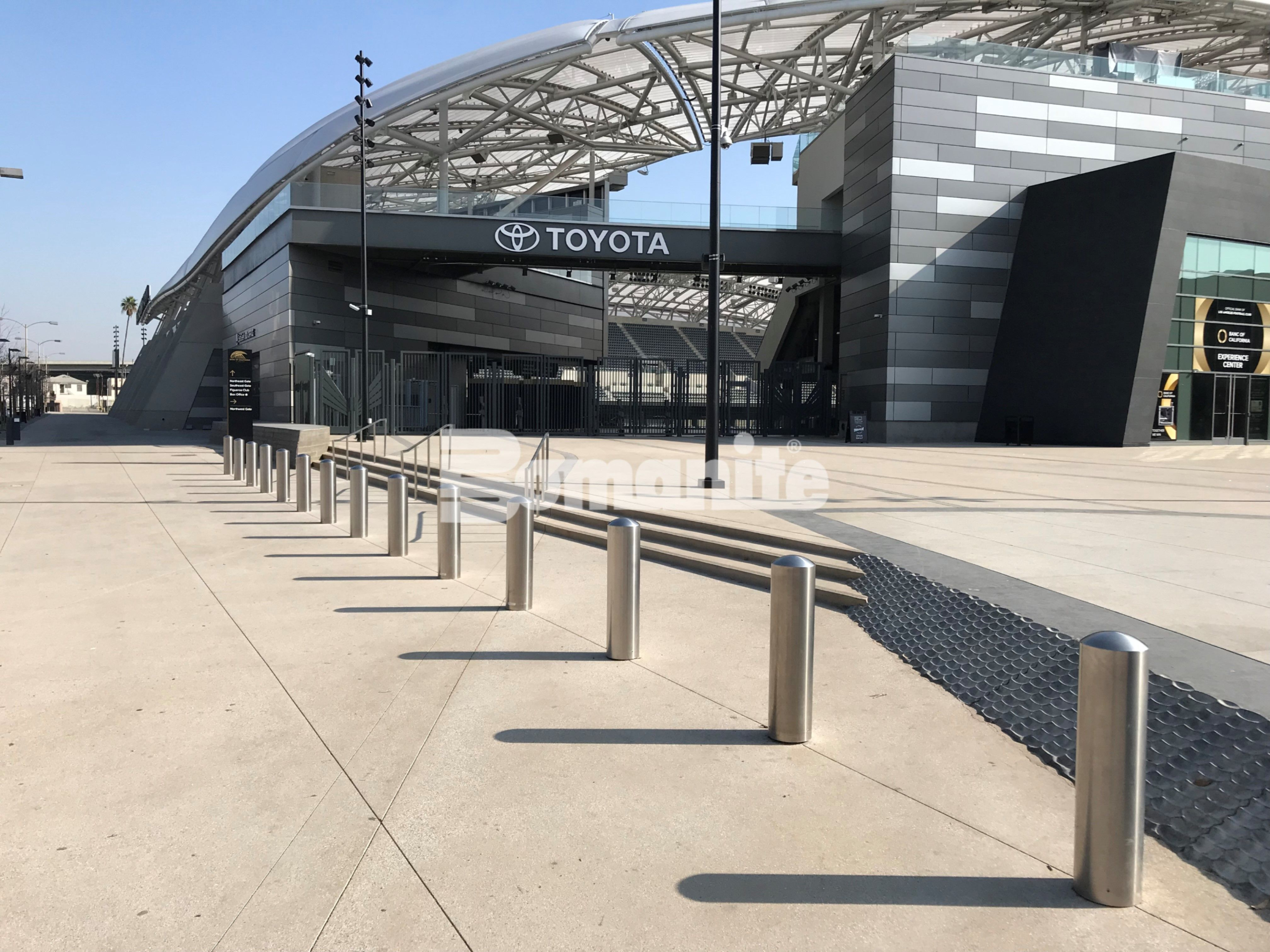 Banc of Calif LAFC Stadium decorative concrete installed by Bomel Construction featuring Bomanite Sandscape Texture Walkway with Bomanite Alloy Gray Bands.